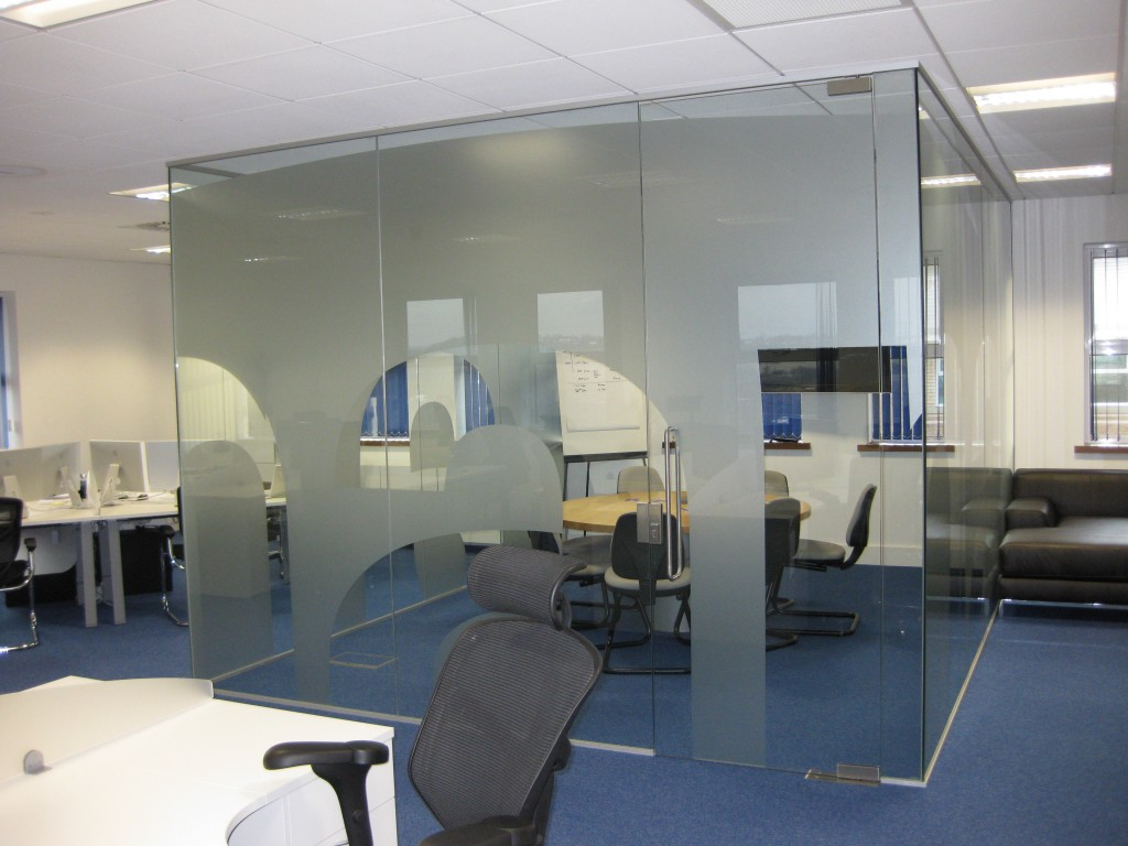 A conference room in the center of the office enclosed by glasses
