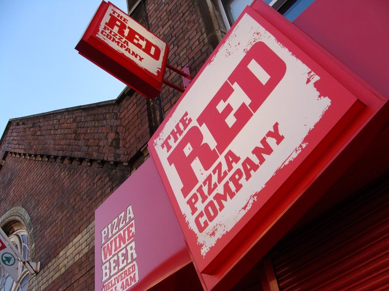Close up view of the storefront designs of The Red Pizza Company